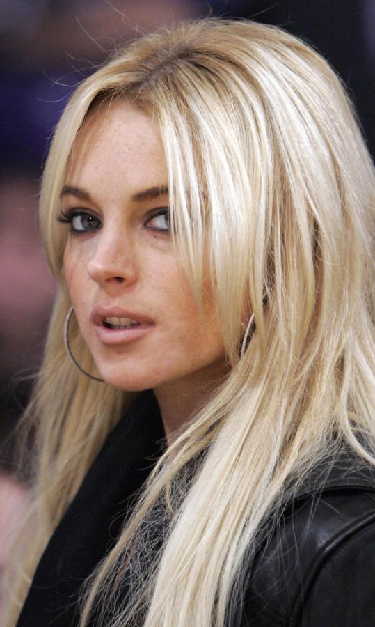 ** FILE ** Actress Lindsay Lohan is seen at the Los Angeles Lakers game against the Orlando Magic in their NBA basketball game, in this Dec. 2, 2007, file photo in Los Angeles. Court papers filed Tuesday, Dec. 4, 2007, allege the busboy who sued Lindsay Lohan has proof the actress had been drinking before she collided with his van in October 2005. Raymundo Ortega contends that Lohan drove her Mercedes-Benz into a van he was driving after she drank alcohol and later tried to escape paparazzi. He is seeking 0,000 in damages.  (AP Photo/Mark J. Terrill, file)