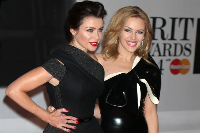 Kylie i Dannii Minogue na gali Brit Award 2014
