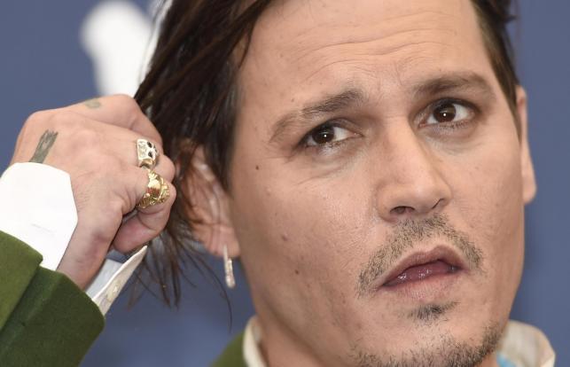 Johnny Depp podczas konferencji prasowej